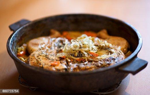 Whole just stewed chicken Tabaka, Georgian style on pan