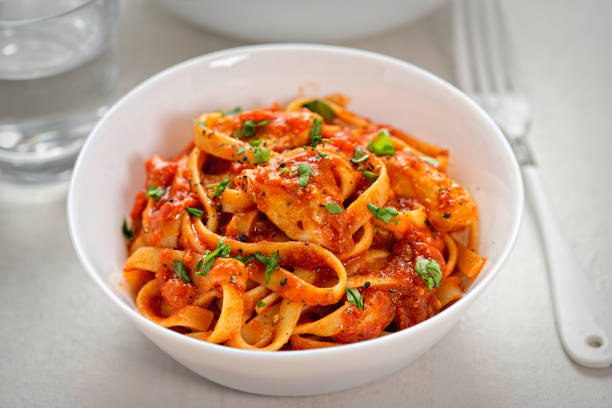 Chicken tagliatelle in tomato sauce Chicken tagliatelle in creamy tomato sauce tagliatelle stock pictures, royalty-free photos & images