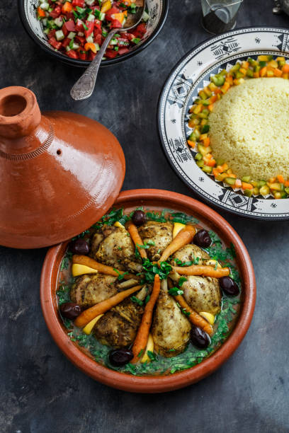 Chicken tajine with couscous and salad, morrocan cuisine stock photo
