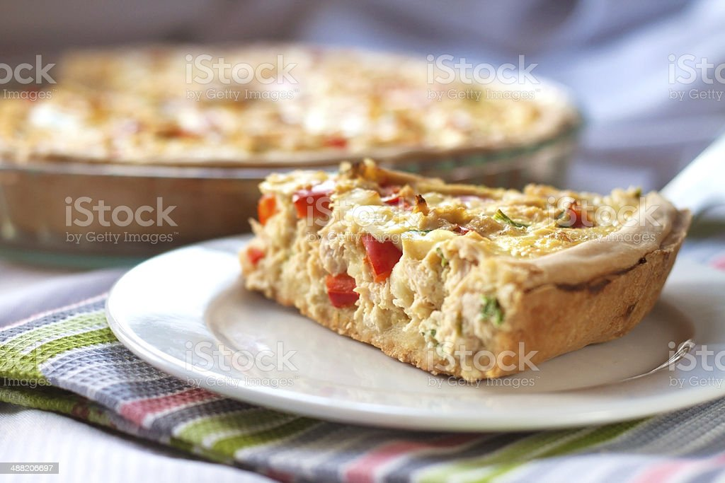Chicken tart with paprika and goat cheese stock photo