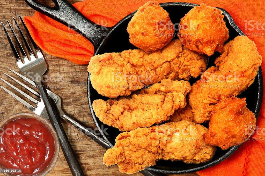Chicken Tenders and Hush Puppies stock photo
