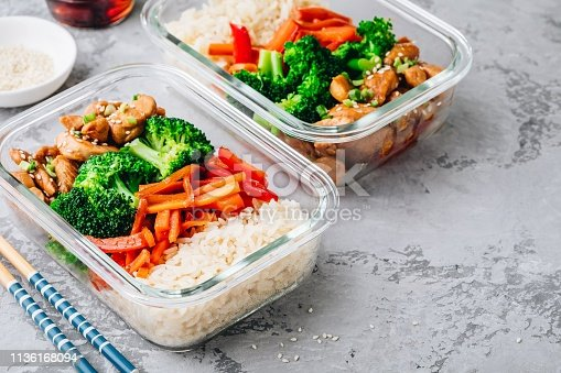 Chicken teriyaki stir fry meal prep lunch box containers with broccoli, rice and carrots