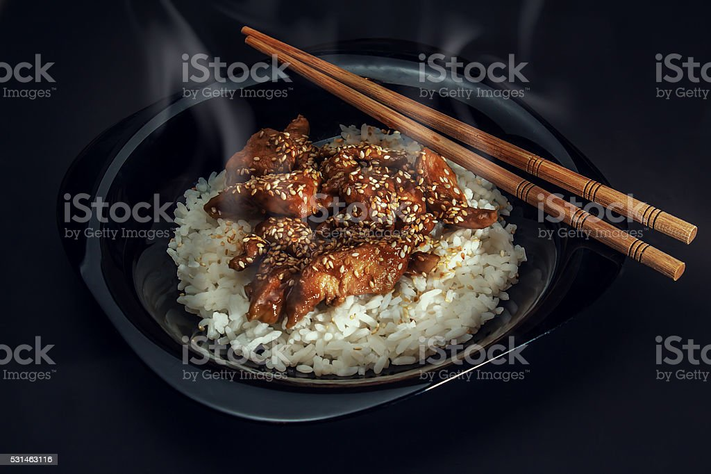 Chicken teriyaki with steamed rice. stock photo