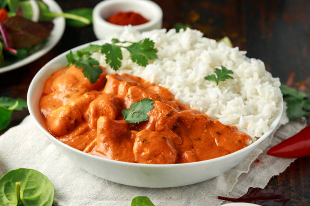 Chicken tikka masala curry with rice and naan bread stock photo