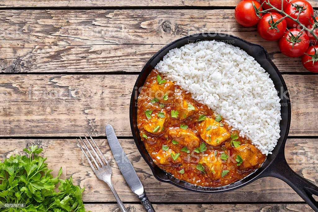 Chicken tikka masala Indian traditional spicy meat food and rice stock photo