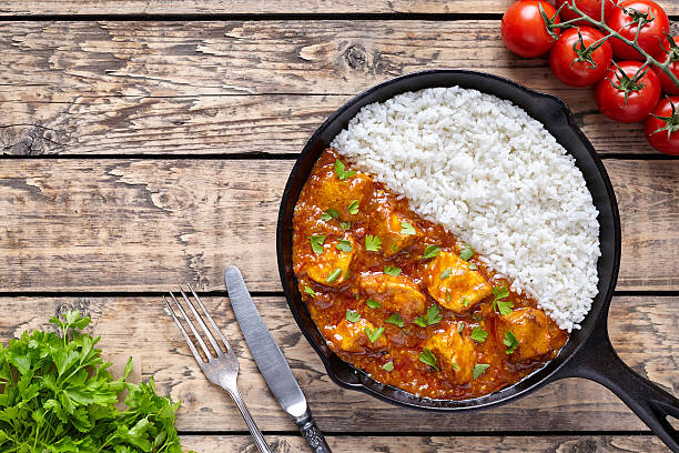 chicken tikka masala indian traditional spicy meat food and rice - chicken rice stock photos and pictures