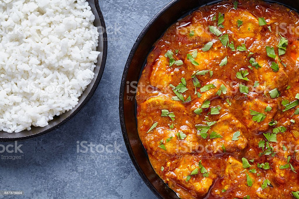 Chicken tikka masala national Indian spicy meat food with butter stock photo
