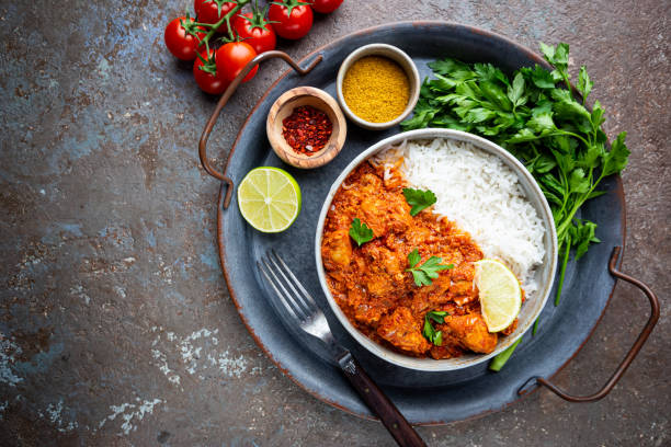 Chicken tikka masala Chicken meat with tikka masala sauce, spicy curry food in a bowl with rice and seasonings, top view balti dish stock pictures, royalty-free photos & images