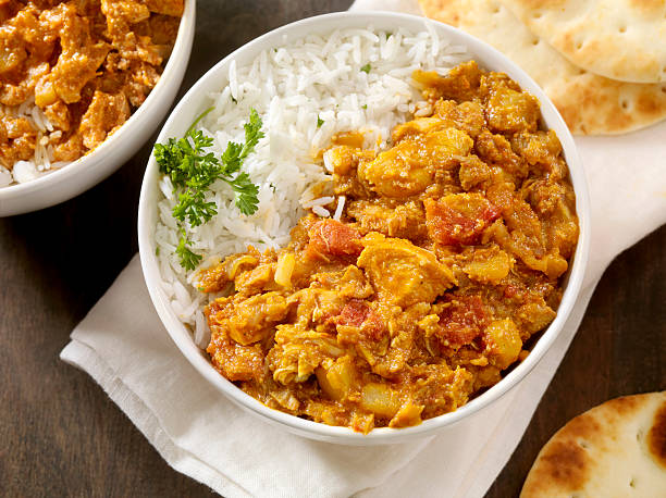 Chicken tikka masala Chicken tikka masala with Basmati Rice and Naan Bread -Photographed on Hasselblad H1-22mb Camera butter chicken stock pictures, royalty-free photos & images