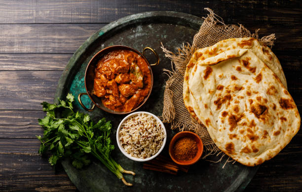 Chicken tikka masala spicy curry meat food with rice and naan bread Chicken tikka masala spicy curry meat food with rice and naan bread on dark background naan bread stock pictures, royalty-free photos & images