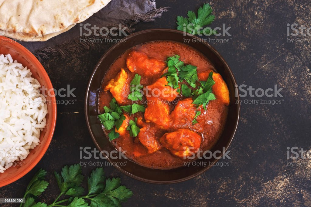 Chicken tikka masala with rice. Asian-Indian dish. Top view, copy space. - Zbiór zdjęć royalty-free (Azja)