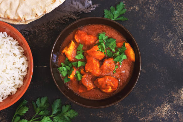 chicken tikka masala with rice. asian-indian dish. top view, copy space. - indian food stock pictures, royalty-free photos & images