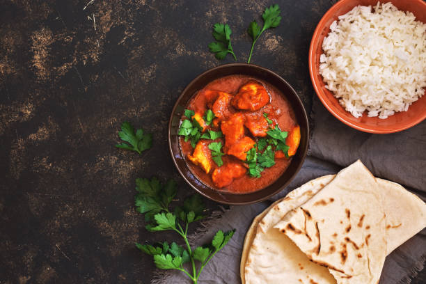 Chicken tikka masala with rice. Indian food. Top view, copy space. Chicken tikka masala with rice. Indian food. Top view, copy space naan bread stock pictures, royalty-free photos & images
