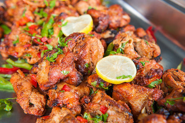 Chicken tikka tandoori at an indian restaurant buffet stock photo