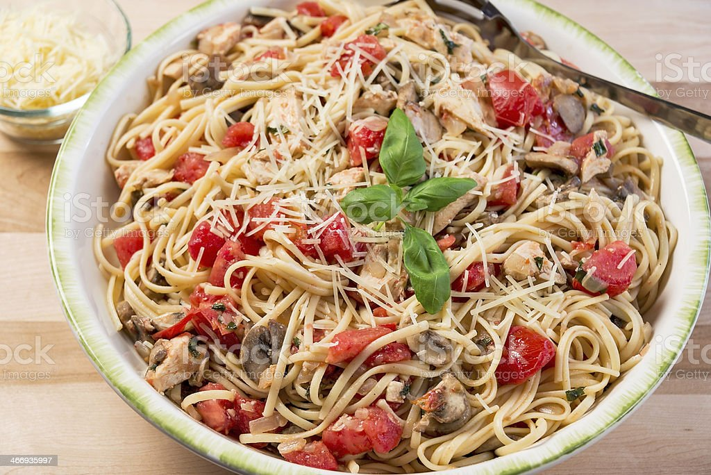 Chicken, tomato and basil linguine stock photo