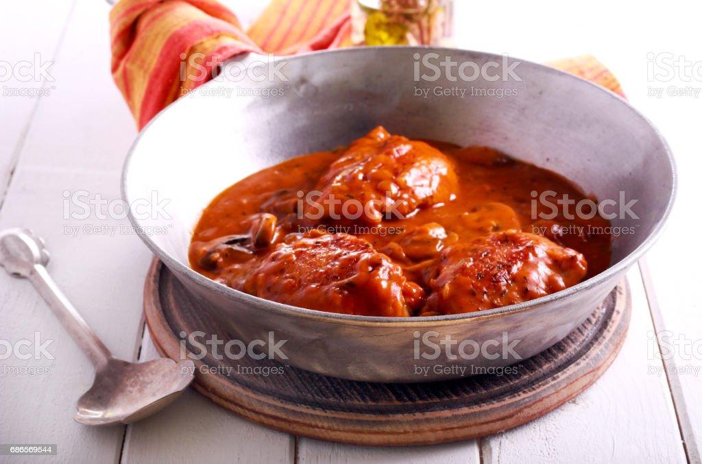 Poulet Valence - cuisses de poulet compotées photo libre de droits