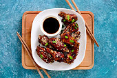 Chicken wings cooked on asian style recipe, view from above, flatlay composition