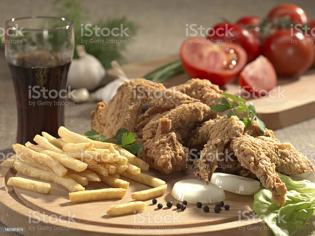 Chicken wings, fries and vegetables. royalty-free stock photo