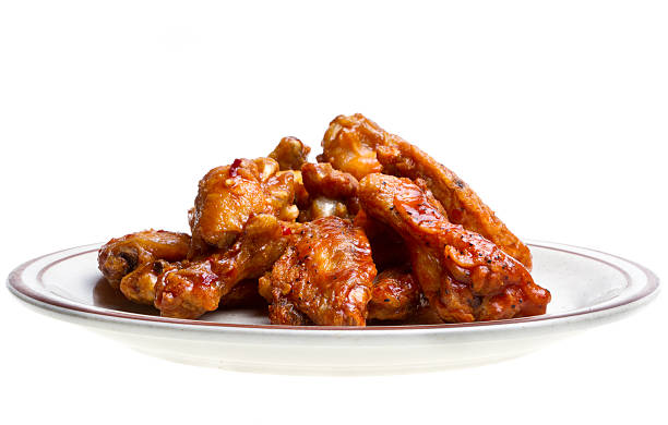 chicken wings isolated on white - animal wing stock photos and pictures