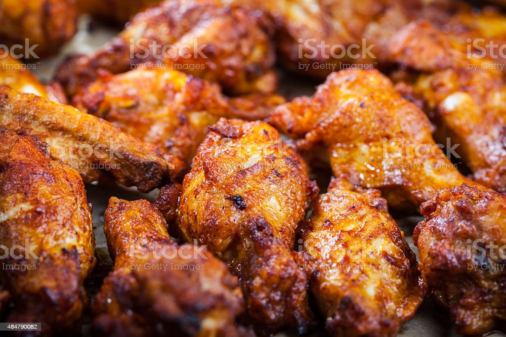 Chicken wings on baking sheet stock photo
