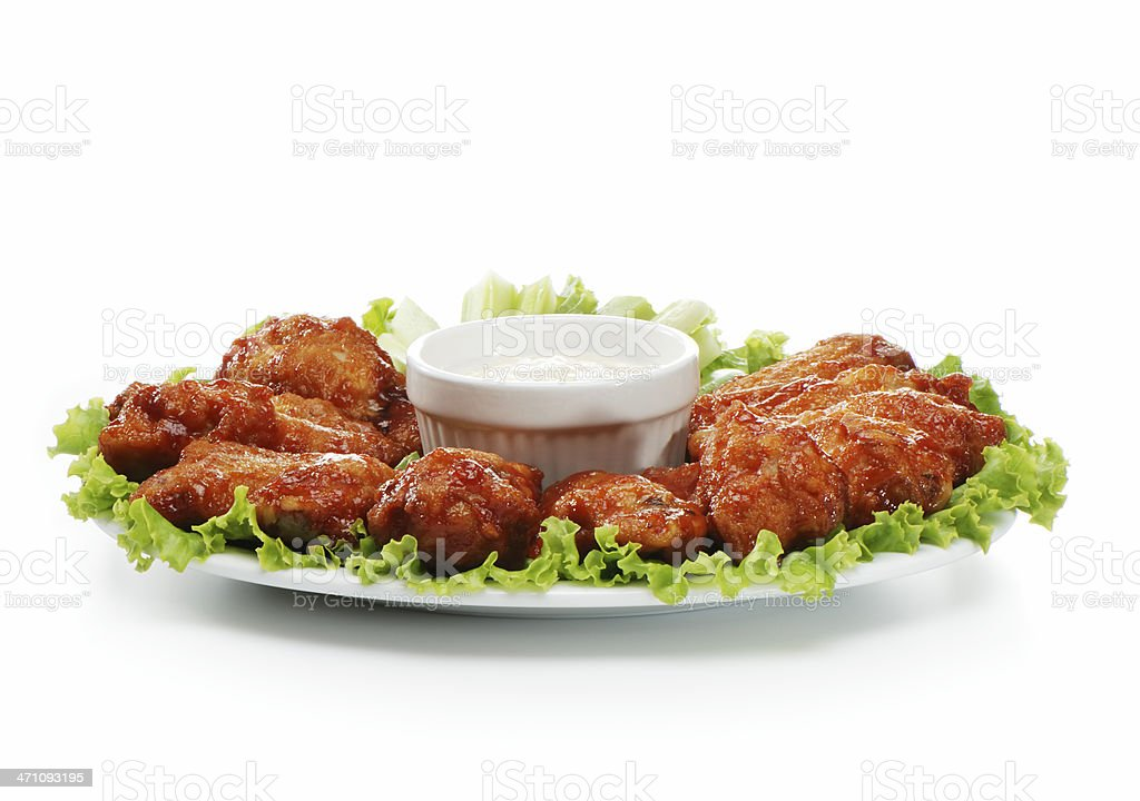 Chicken wings served on a plate with a dip  stock photo