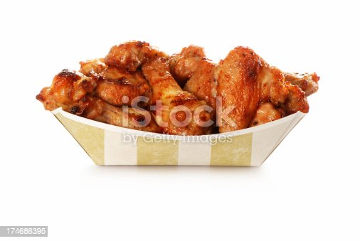 Stack of chicken wings in take out container. Check my wings lightbox.