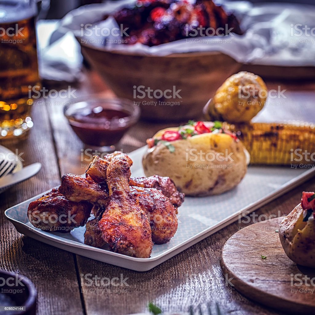 Chicken Wings with Baked Potato and Corn stock photo