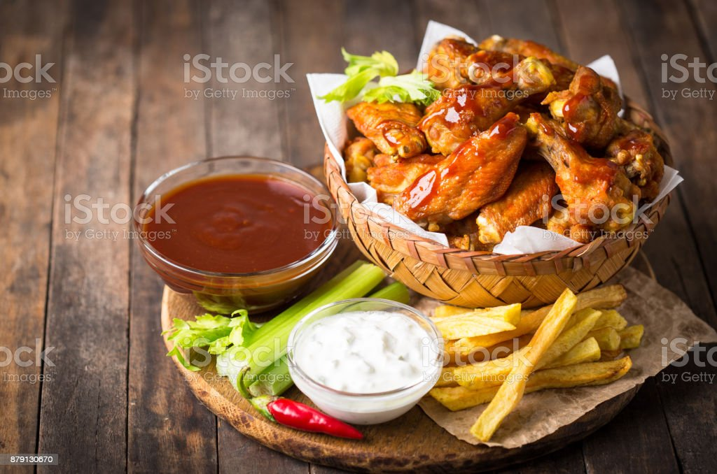 Chicken wings with dips on the wooden table stock photo