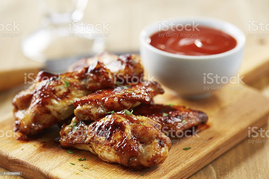 Chicken wings with sriracha sauce stock photo