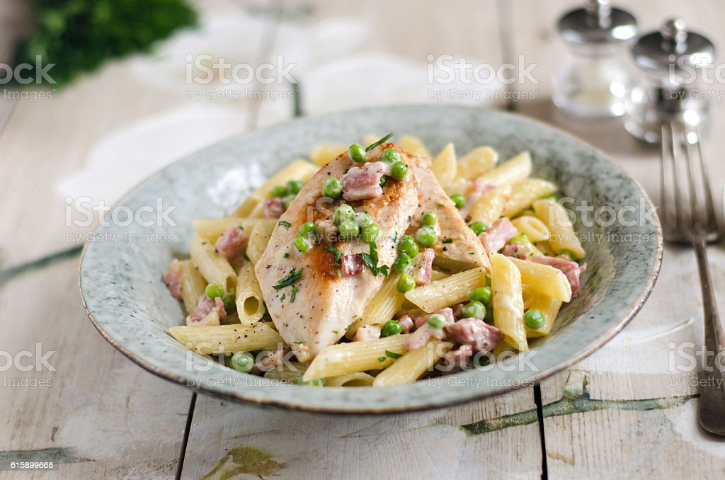 Chicken with creamy bacon penne stock photo