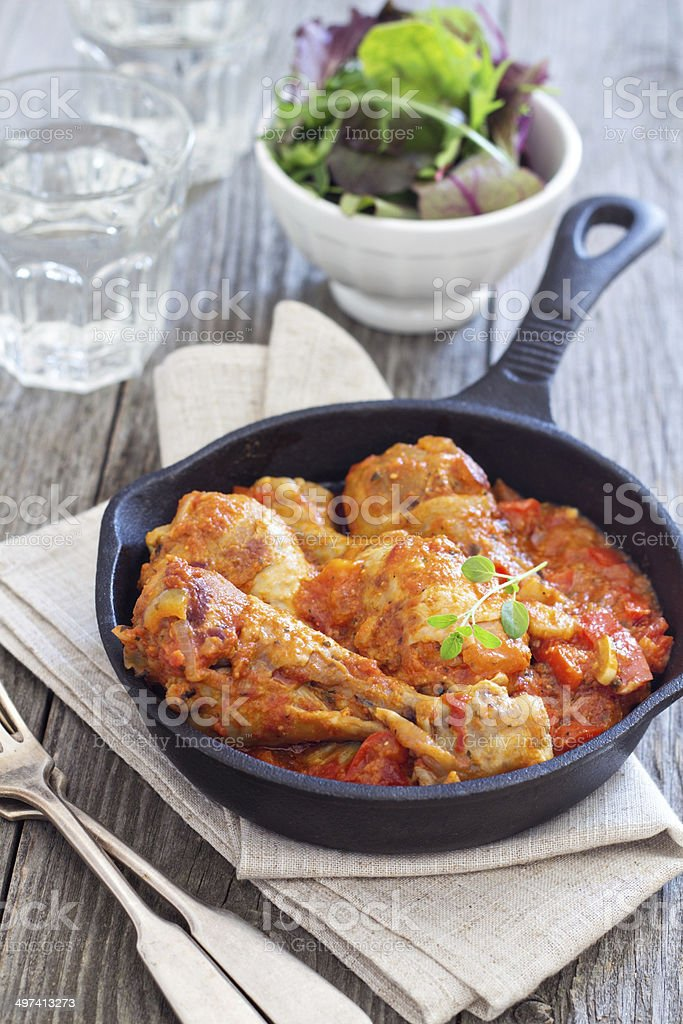 Chicken with mustard and red peppers stock photo
