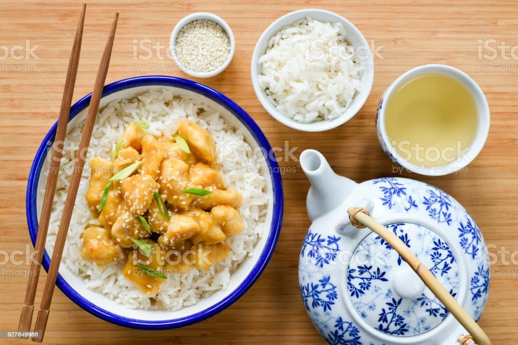 Chicken with rice, china teapot and green tea stock photo
