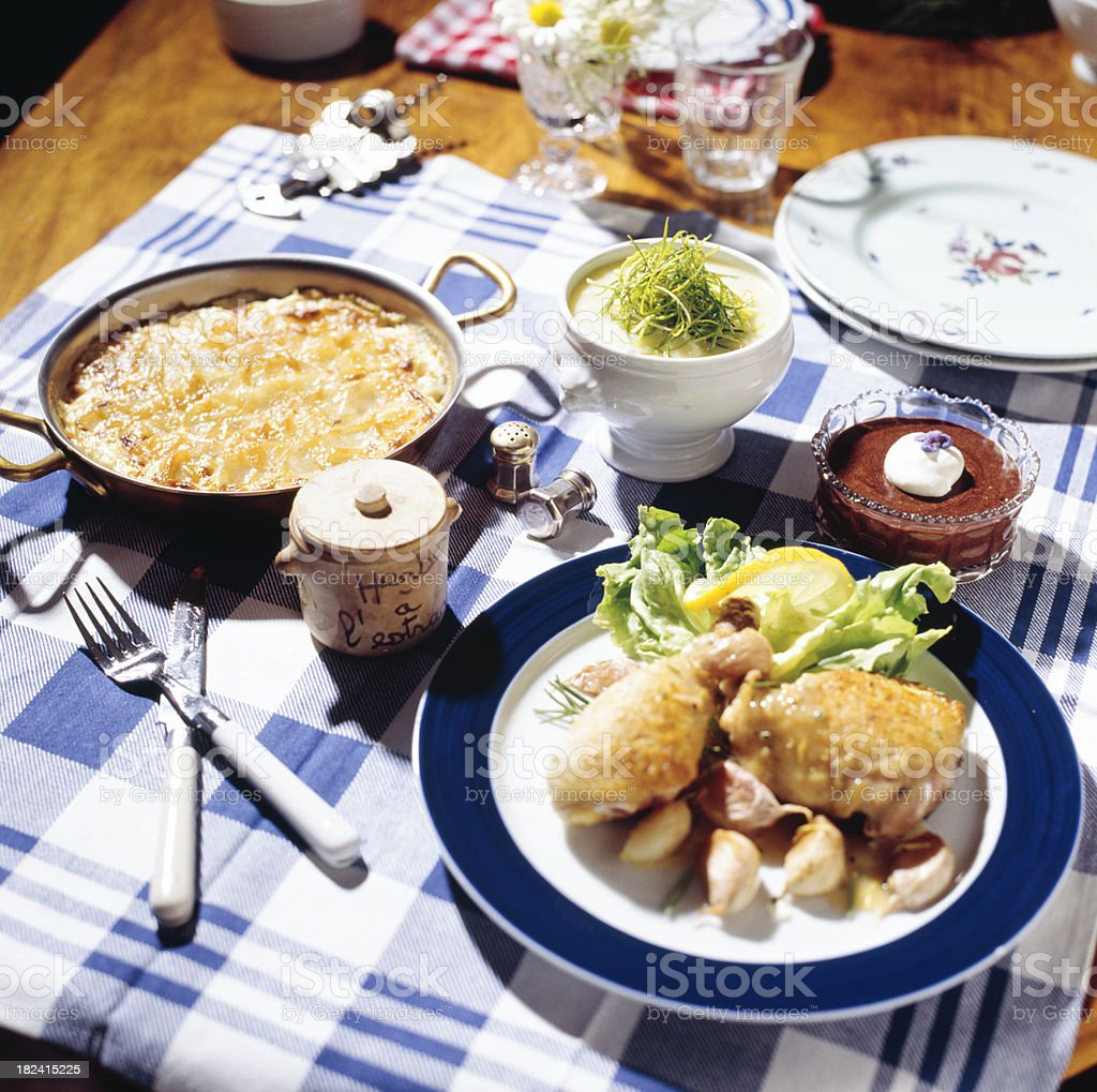 Chicken with scalloped potaoes served on dinner table royalty-free stock photo