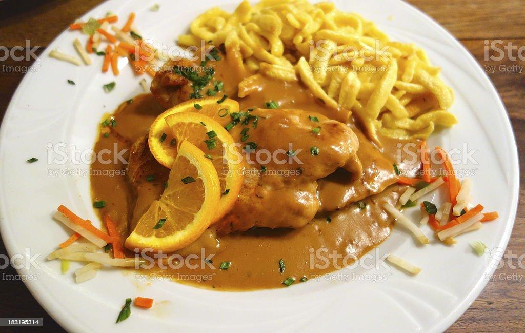 Chicken with spätzle stock photo