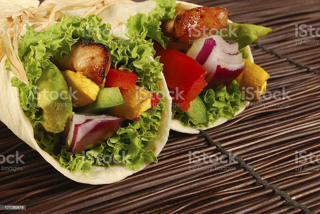 Chicken wrap sandwiches on mat royalty-free stock photo