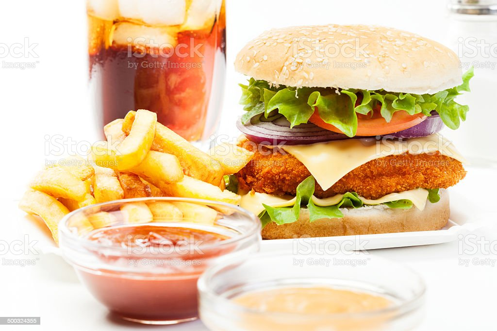 Chickenburger and glass of cola with ice royalty-free stock photo