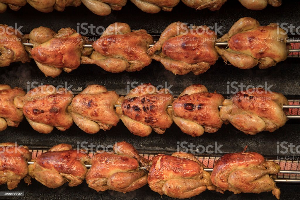Chickens on the rotisserie stock photo