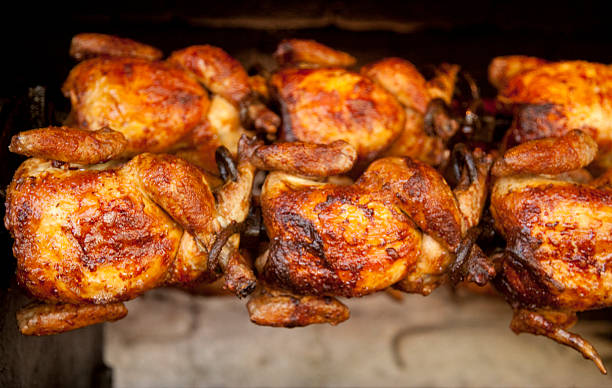 Chickens Roasting on Rotisserie, Food, Grilling, Cooking, Poultry  spit roasted stock pictures, royalty-free photos & images