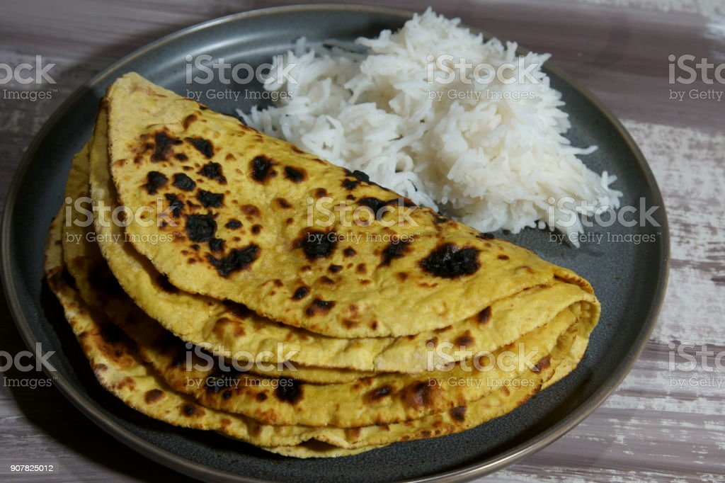 Chickepea flour flat bread or besan ki roti with rice. stock photo