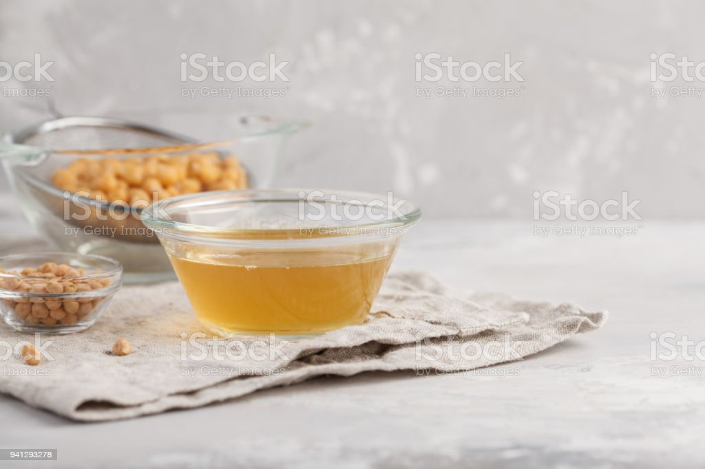 Chickpea broth - aquafaba. Replace egg in baking for vegan recipe, copy space. Healthy diet concept. stock photo