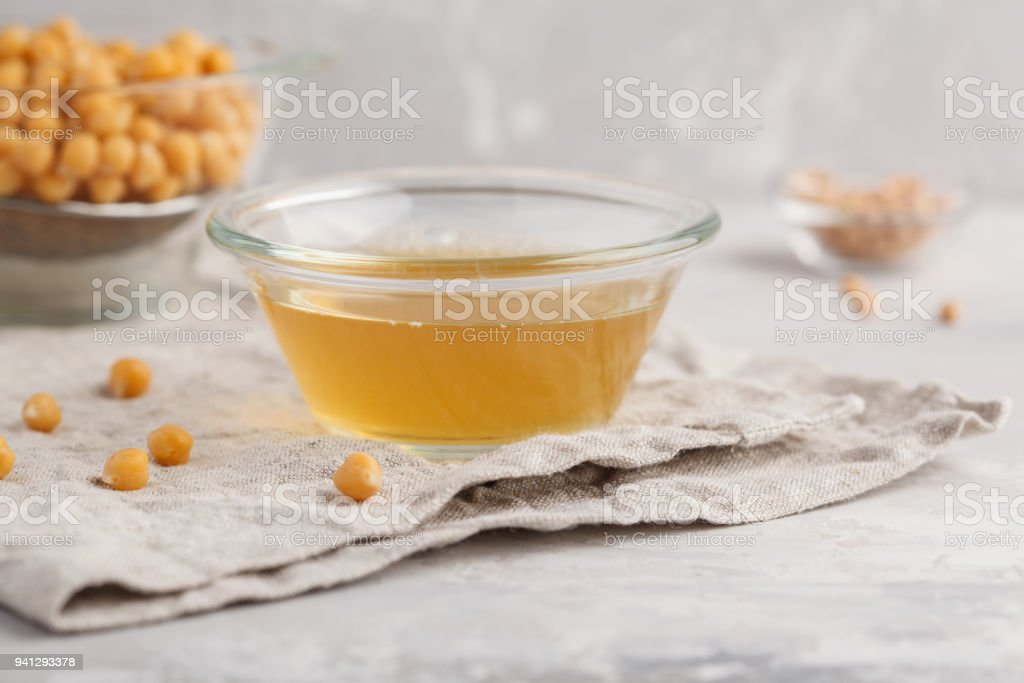 Chickpea broth - aquafaba. Replace egg in baking for vegan recipe. Healthy diet concept. stock photo