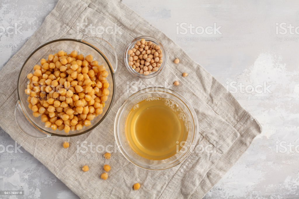 Chickpea broth - aquafaba. Replace egg in baking for vegan recipe, top view, copy space. Healthy diet concept. stock photo