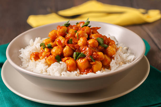 Chickpea curry Homemade chickpea curry with basmati rice curry powder stock pictures, royalty-free photos & images