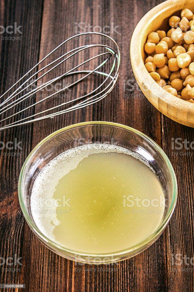 Chickpea liquid water brine draining. Vegan Aquafaba stock photo