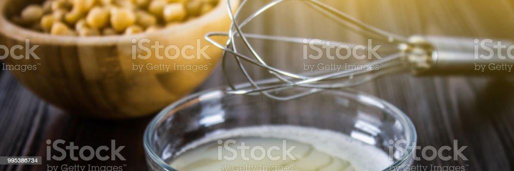 Chickpea liquid water brine draining. Vegan Aquafaba. stock photo