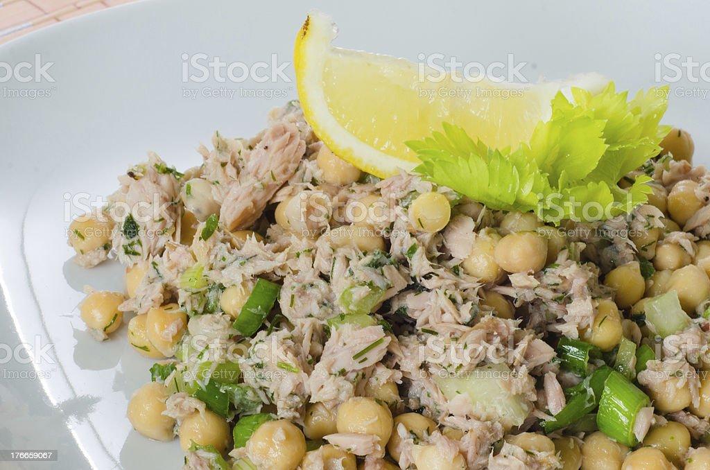 Chickpea salad with tuna, lemon and herbs royalty-free stock photo