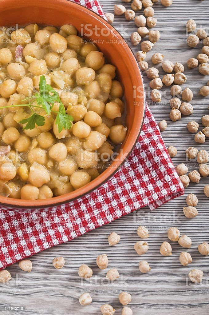 Chickpea soup in terracotta bowl. royalty-free stock photo