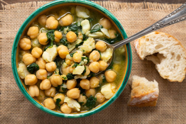 Chickpea soup with spinach and cod stock photo