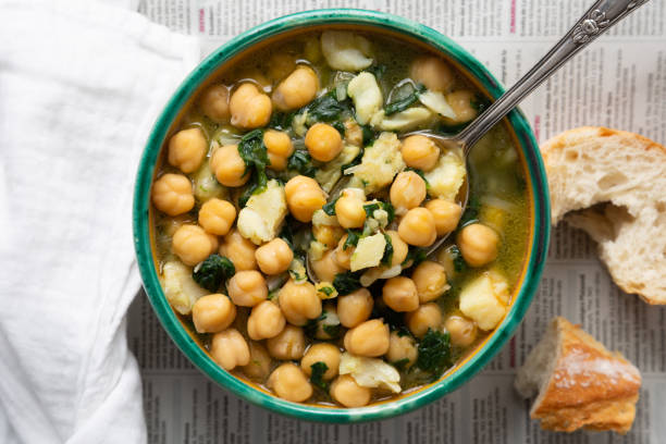 Chickpea stew with spinach and cod stock photo