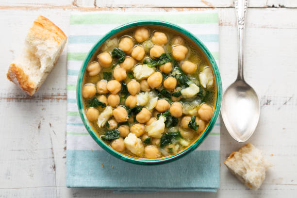 Chickpea stew with spinach and dry salted cod stock photo